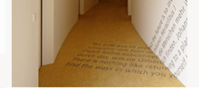 Corridor inside of the HSG Alumni House with a lettering as ground and wall decoration.